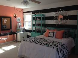 teal and coral bedroom for girls with vertical striped accent with