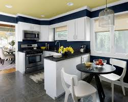 kitchen color schemes with wood cabinets grey tile floor island