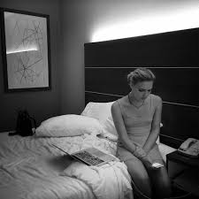 In the Operating Room During Gender Reassignment Surgery Picture of a girl sitting on the edge of her bed