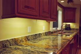 Inside Kitchen Cabinet Lighting by Elegant Led Light Cabinet With Awesome Granite Top Table Combined