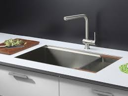 brushed nickel faucet with stainless steel sink a simple guide to the pros and cons of zero radius kitchen sinks