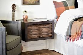 nice floating bedside table featuring polished wooden body with