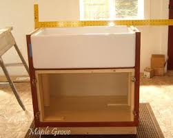 kitchen base cabinets for farmhouse sink at maple grove how to build a support structure for a farm