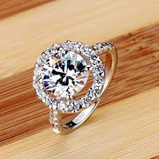 crystal diamond rings images Luxury small crystal surround four pronged shining diamond wedding jpg