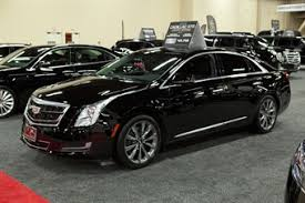 cadillac xts sedan cadillac to add suvs refreshed xts sedan vehicles limousine
