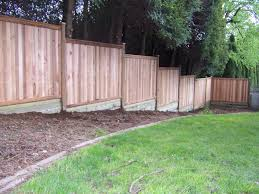 privacy fence building build a fence on sloped ground backyard