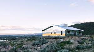 american artist doug aitken installs fully mirrored cabin in the