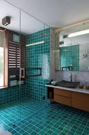 blue and beige bathroom black frame rectangular mirror on white