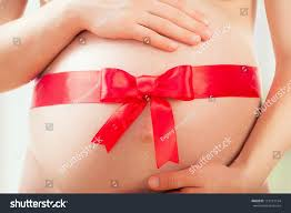 belly pregnant woman red ribbon bow stock photo 119151154