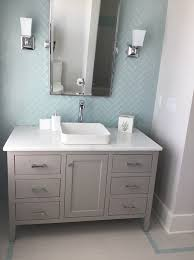 the vanity is painted vanity in a soft gray sherwin williams