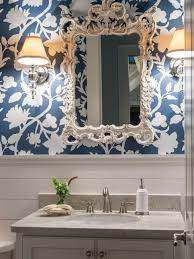 25 sensational small bathroom ideas on a budget melbourne fl graphic floral designer wallpaper in navy the elegant crystal sconces with polished nickel arms look expensive but are affordable at less than 80