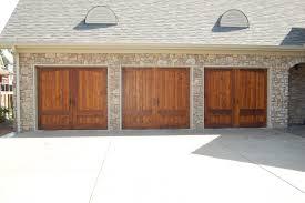 garage doors cunningham door window prestained cedar design steel