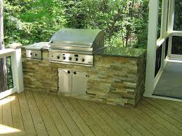 cool stone outdoor kitchen island features brown color wooden