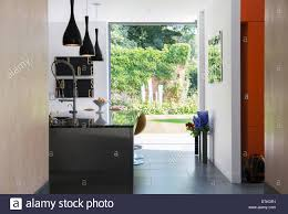modern kitchen window view of garden through modern kitchen window stock photo royalty