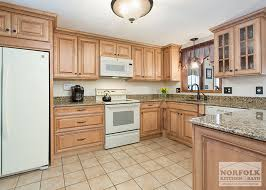 maple kitchen cabinets with white granite countertops tewksbury kitchen remodel with maple cabinets walnut glaze