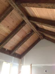 the ceiling material is 1x10 antique heart pine that was cut from
