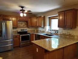what color backsplash with honey oak cabinets giallo ornamental and med oak cabinets backsplash help