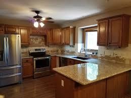 what color backsplash goes with honey oak cabinets giallo ornamental and med oak cabinets backsplash help