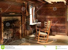 dark interior of old log cabin built in the 1800s stock photo