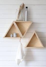Triangle Wall Shelf Triple Floating Triangle Shelves Placed On The White Wooden Wall