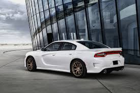 2015 dodge charger srt hellcat price the tesla model s p85d and the dodge charger srt hellcat are two