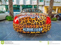 lexus hotel dubai panther paint bentley parked outside the hilton dubai hotel