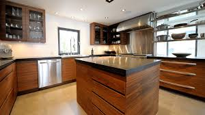 modern kitchen in walnut and stainless ateliers jacob calgary