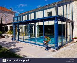 indoor swimming pool in garden of upmarket gite or holiday home in