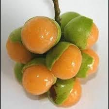 Teh Fruity kenep fruit green skin remove on fleshy orange once the