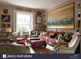 london home shabby chic living room with velvet armchairs and