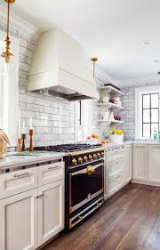 la cornue cornufé stove gloss black marble subway tile backdrop