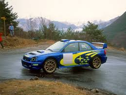 subaru justy rally richard burns flying his wrc impreza during the tour de corse