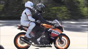 honda cbr motorbike 2up riding passenger on a sport bike too many balls on one