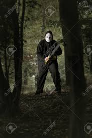 chainsaw halloween mad man with chainsaw in the woods halloween and horror concept