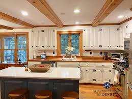 white kitchen cabinets wood trim should i paint my oak cabinets or keep them stained