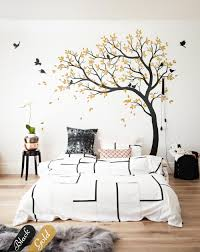large black tree nursery wall design with cute birds and leaves