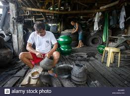 car junkyard in the philippines recycling of old truck tires to build furniture south luzon stock