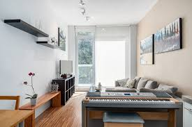 small modern apartment apartments keyboard tucked in beautifully behind the living room