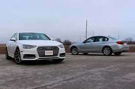 bmw 328i xdrive vs audi a4 quattro 2017 audi a4 vs bmw 3 series comparison review autoguide com