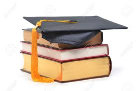graduation books graduation cap on stacked books stock photo picture and royalty