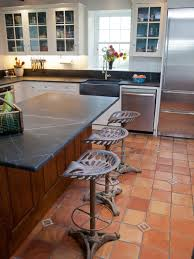 kitchen floor granite countertop and wooden dining chairs and
