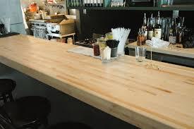 hand made butcher block bar in brooklyn restaurant by sawn custom