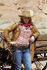 film de cowboy portrait of beautiful cowgirl western movie style stock photo