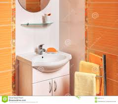 of a luxurious bathroom with accessories with orange and white