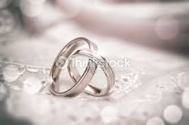 linked wedding rings linked wedding rings stock photo thinkstock