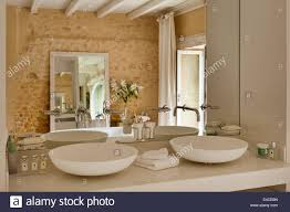 Agape Bathroom Fixtures by Twin Spoon Cer 700 Basins By Agape In Bathroom With Rough Stone