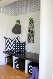 modern entryway paint color with small green hook on streaky grey