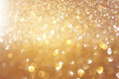 glitter vintage lights background light gold black defocused stock