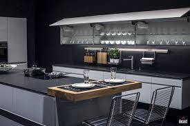 gray island black solid countertop electric cooktop industrial bar