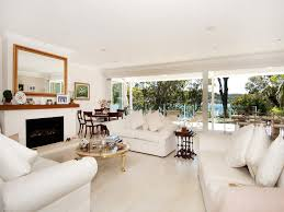 Open Plan Kitchen Living Room Flooring Open Plan Living Room Using White Colours With Carpet U0026 Bi Fold